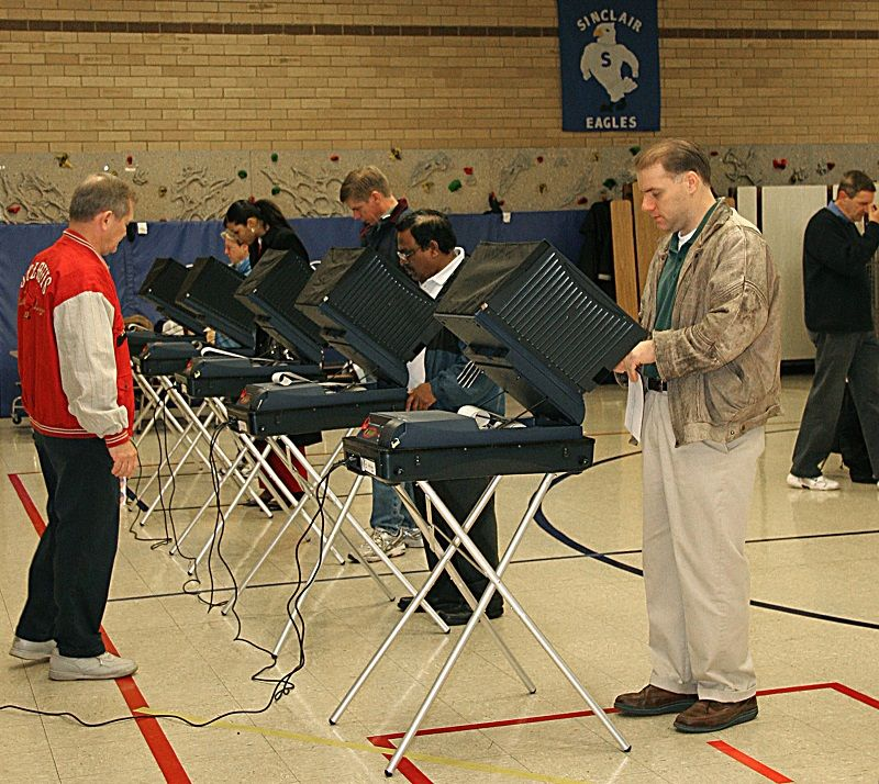 Voters cast their ballots on electronic voting machines 07 November, 2006 at the Sinclair Elementary School in Prince William County, Virginia.