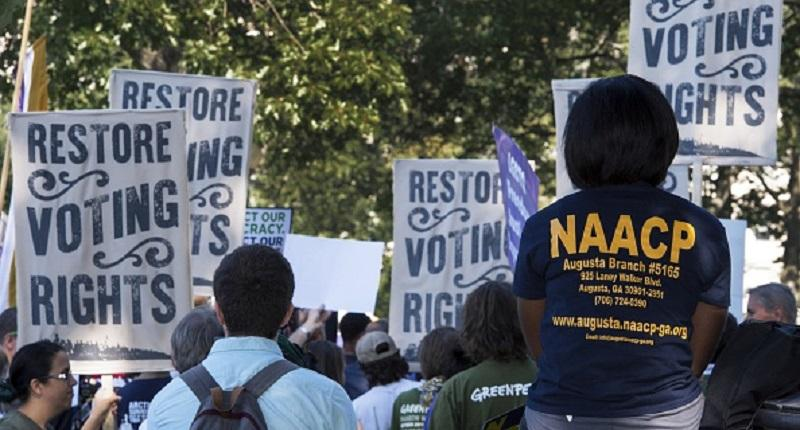 Various labor unions and progressive organizations protest on Capitol Hill on Sept. 16, 2015, calling for the restoration of the Voting Rights Act struck down by the US Supreme Court.