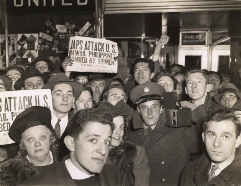 A crowd (with at least one member of the armed forces among them) gathers in Times Square after the Japanese attack on Pearl Harbor, New York, New York, December 8, 1941.