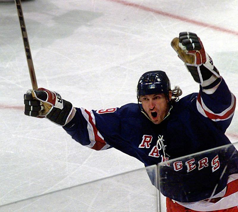 New York Rangers' Wayne Gretzky (99) celebrates scoring a goal in the third period to tie the Dallas Stars in Dallas, Friday, Nov. 7, 1997 The Stars and Rangers skated to a 2-2 tie.
