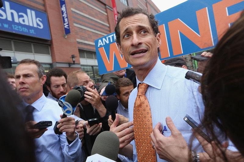 Anthony Weiner is surrounded by media while courting voters outside a Harlem subway station a day after announcing he will enter the New York mayoral race on May 23, 2013 in New York City.