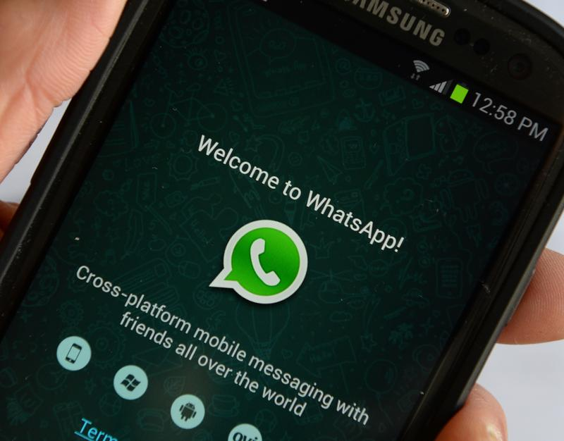 Logo of WhatsApp, the popular messaging service bought by Facebook for USD $19 billion, seen on a smartphone February 20, 2014 in New York.