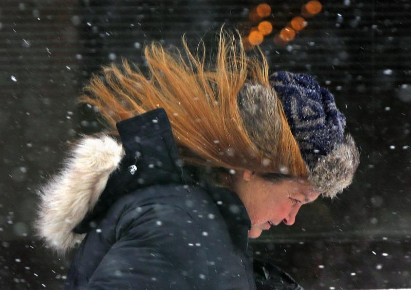 Ann Richards leans into the wind while making her way through wind-driven snow during a winter storm in downtown Portland, Maine, , Monday, Feb. 2, 2015.