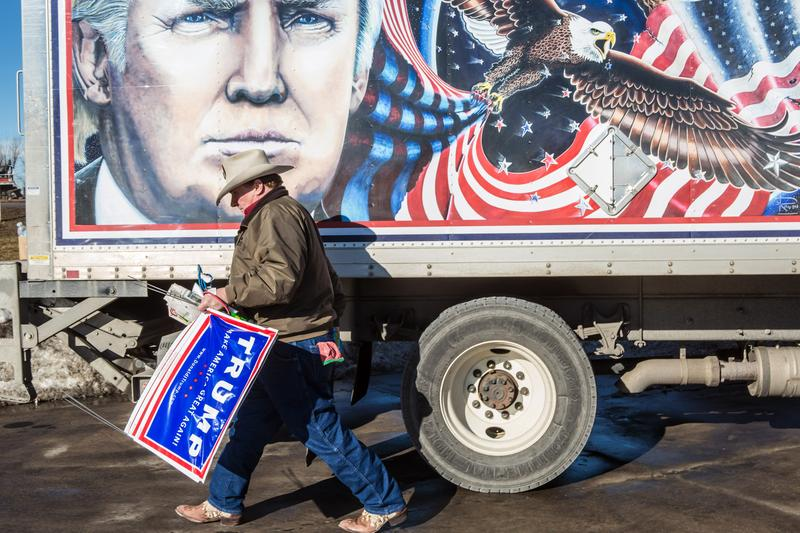 Kraig Moss, a supporter of Republican presidential candidate Donald Trump, outside a truck with a Trump painting in which he is touring Iowa on January 28, 2016 in Des Moines, Iowa.