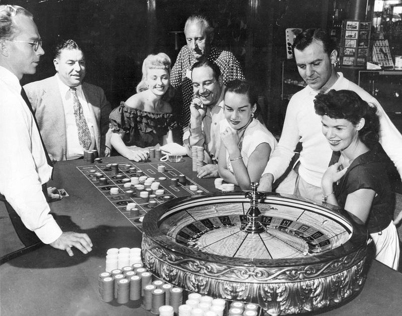 People are shown at one of the gaming tables at the Flamingo Casino in Las Vegas, Nev., May 24, 1955.