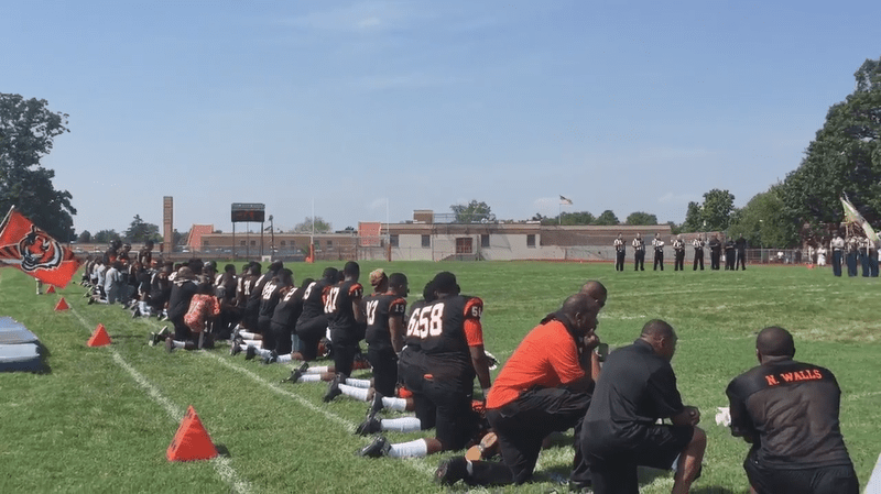 Students and coaches at Woodrow Wilson High School in Camden, New Jersey, protested social inequality Saturday by kneeling for the national anthem.