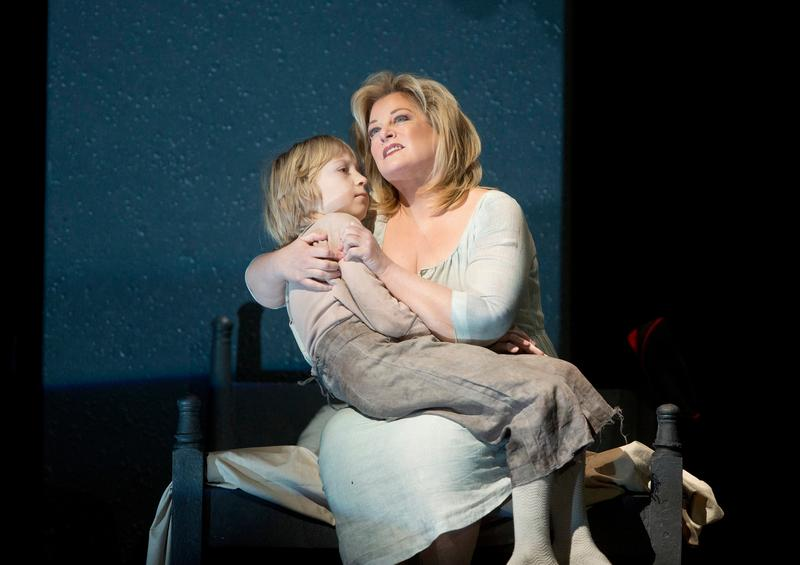 """Anthony Reznikovsky as Marie's child and Deborah Voigt as Marie in Berg's """"Wozzeck."""""""