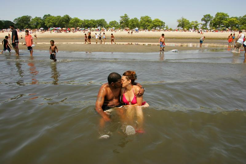 New York NY-7/16/06 ;/ On a very hot day at Orchard Beach-William harrison and his fiancee Gloria Mar - sat in the water to keep cold.