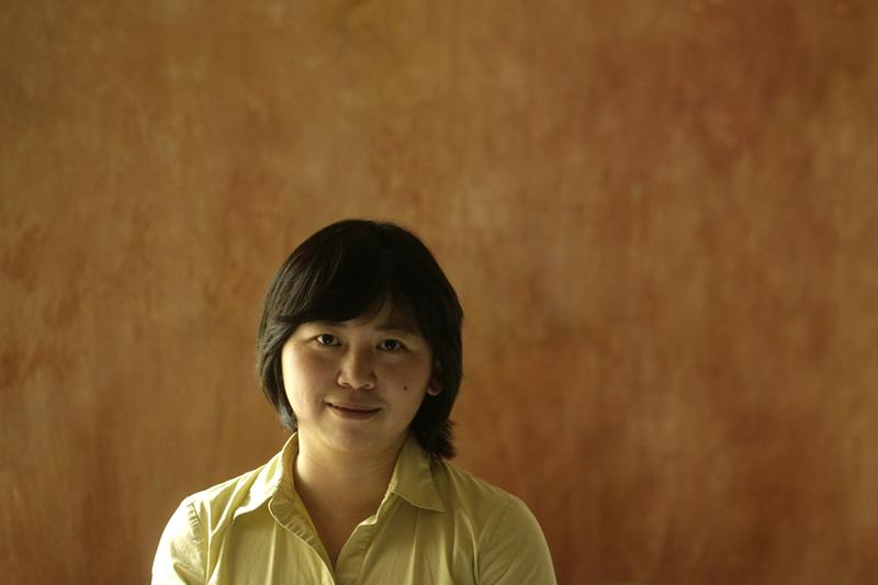 Chinese writer Li Yiyun pose for photographer after a meeting with readers in Hong Kong Tuesday, March 11, 2008. (AP Photo/Vincent Yu)