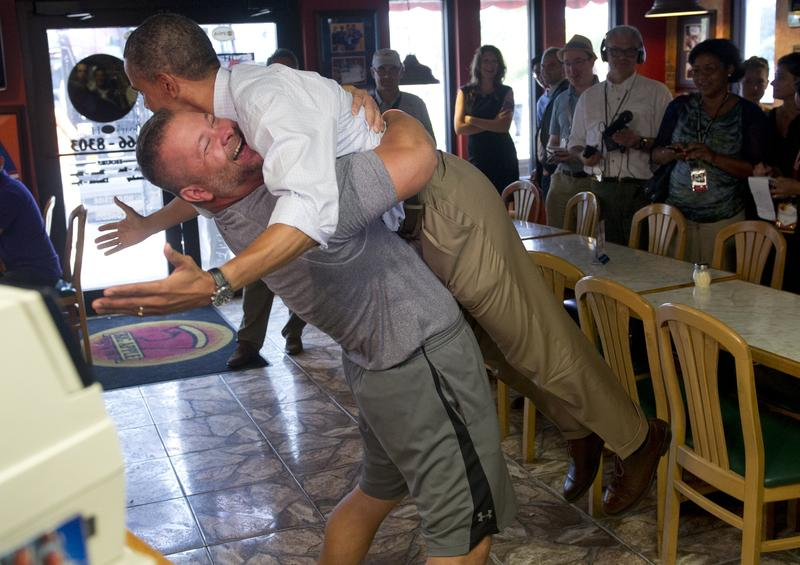 President Barack Obama is picked up by Scott Van Duzer, owner of Big Apple Pizza and Pasta Italian Restaurant during a visit to the restaurant in Fort Pierce, Florida, September 9, 2012