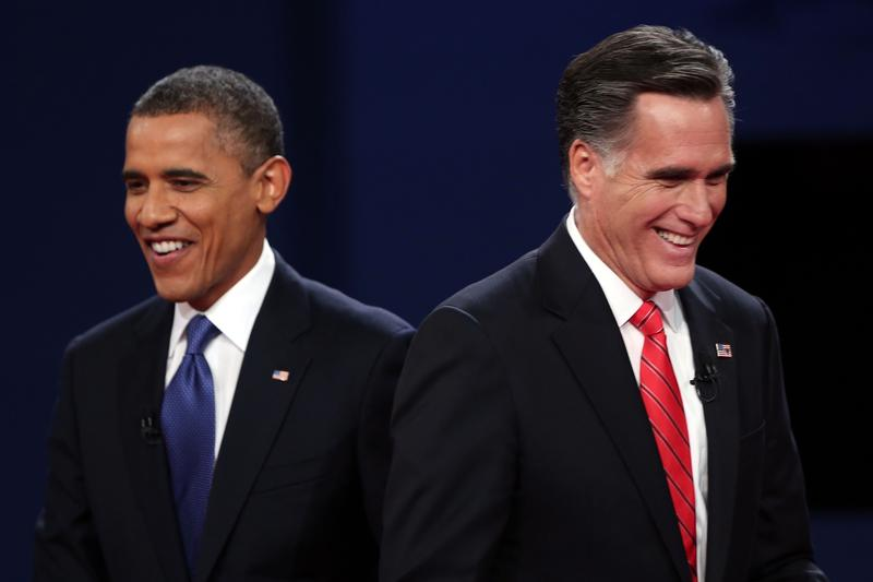 President Barack Obama walks away from Republican presidential candidate Mitt Romney after the Presidential Debate at the University of Denver on October 3, 2012.