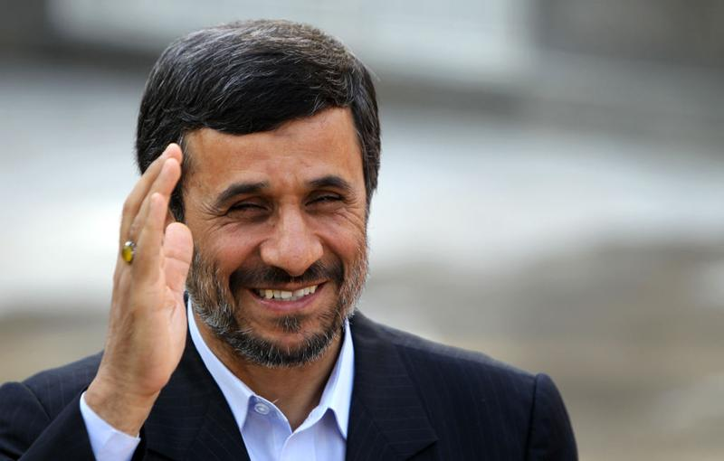 Iranian President Mahmoud Ahmadinejad waves during a welcoming ceremony for his Bolivian counterpart Evo Morales in Tehran on October 26, 2010.
