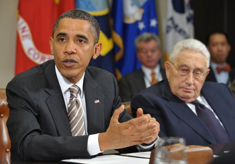 US President Barack Obama speaks during a meeting on the new START Treaty as former Secretary of State Henry Kissinger (R) looks on November 18, 2010 in the White House in Washington, D.C.