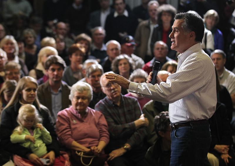 Mitt Romney speaks during a campaign stop on January 1, 2012 in Council Bluffs, Iowa. With two days before the Iowa caucuses, Mitt Romney is continuing his bus tour through Iowa.