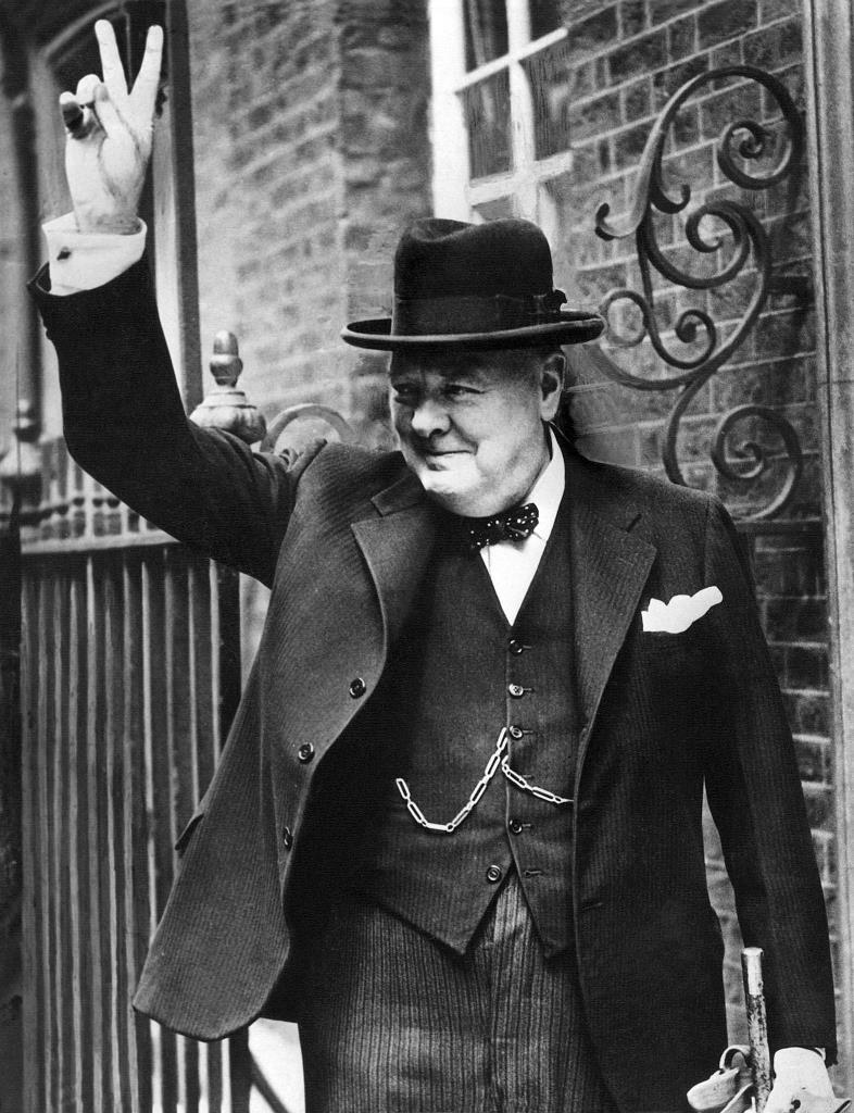 The Prime Minister of Britain, Sir Winston Churchill, is photographed with the famous V for 'victory' in 10 Downing Street after his return to London in 1943.
