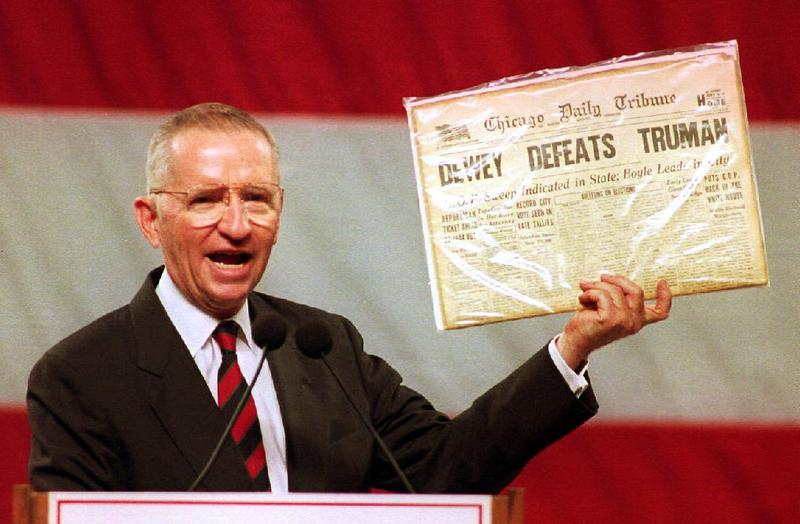 Independent presidential candidate Ross Perot holds up a copy of the famous front page declaring Thomas Dewey the winner over Harry Truman in the 1948 presidential election. (1 Nov 1992)