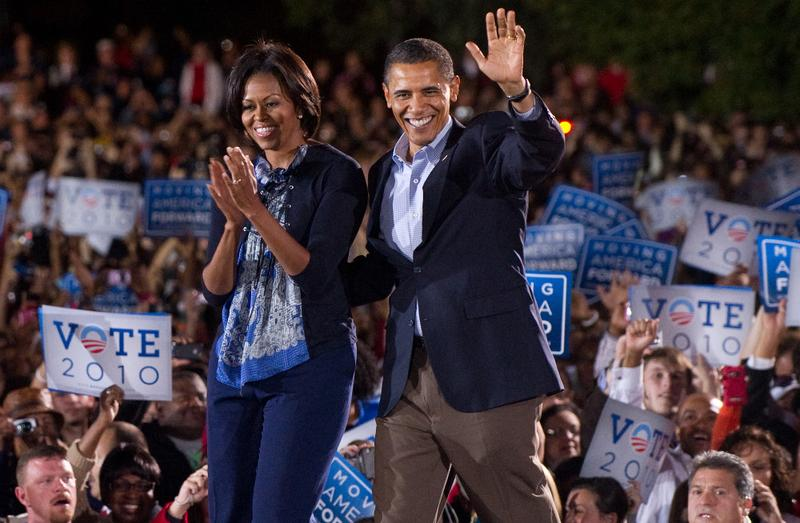 US President Barack Obama and First Lady Michelle Obama arrive for a rally for the Democratic National Committee at Ohio State University in Columbus, Ohio.