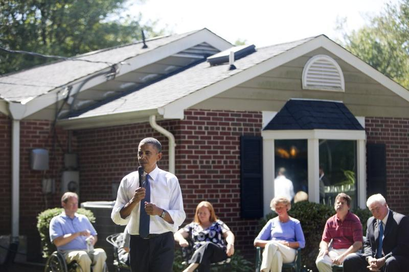 U.S. President Barack Obama holds a backyard discussion at the home of John and Nicole Armstrong to discuss with their neighbors Recovery Act investments on September 13, 2010 in Fairfax, Virginia.