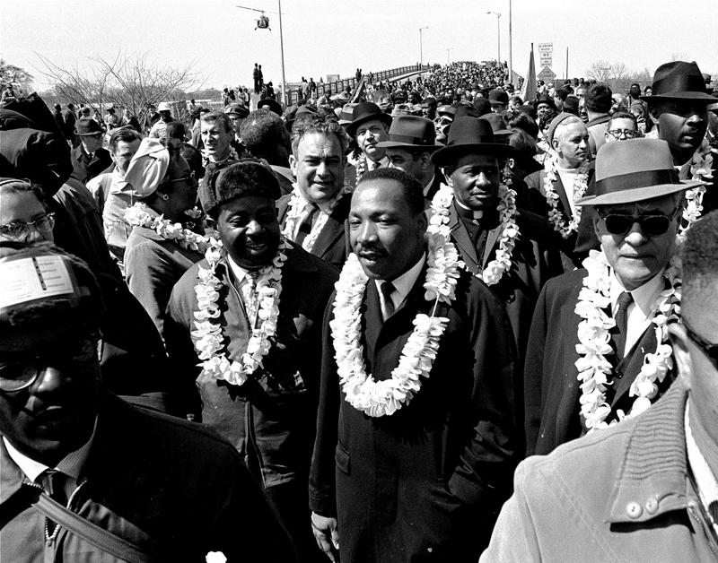 In this March 21, 1965 file photo, Martin Luther King, Jr. &