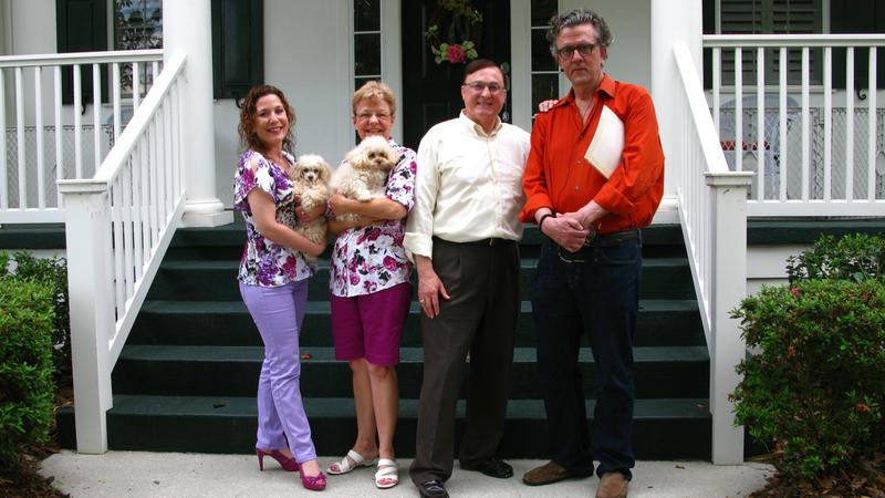 Julie, Marita, and Jim, the Siegel family of Celebration, Florida, in front of their home with host Kurt Andersen