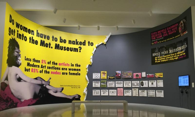An installation of the Guerrilla Girls' protest posters at the Walker Art Center in Minneapolis