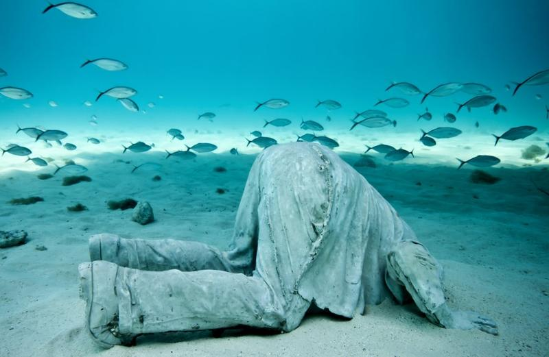 'The Banker' is part of the MUSA Collection and one of a series of sculptures off the coast of Cancun and Isla Mujeres, Mexico