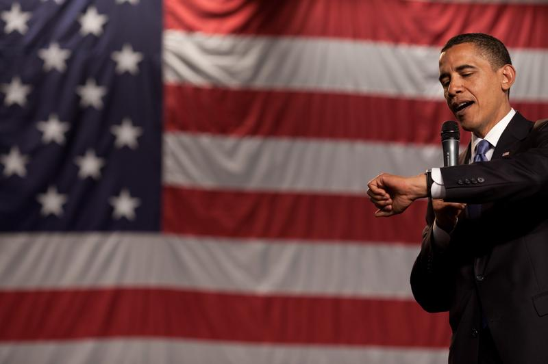 President Obama checks his watch during a town hall meeting for health care reform in Green Bay, Wisconsin.