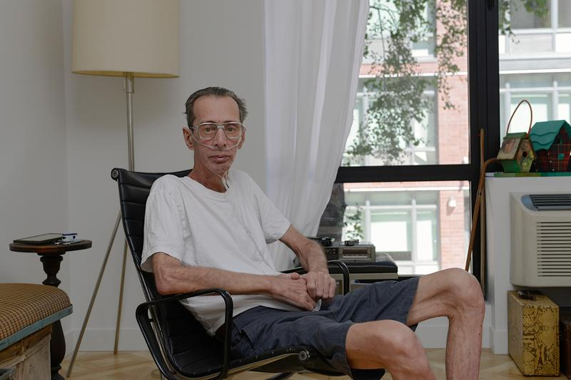 Salvatore Siggia, a former Rivington House patient, at his new apartment inside an elevator building. Nurses and therapists now provide him care at home.
