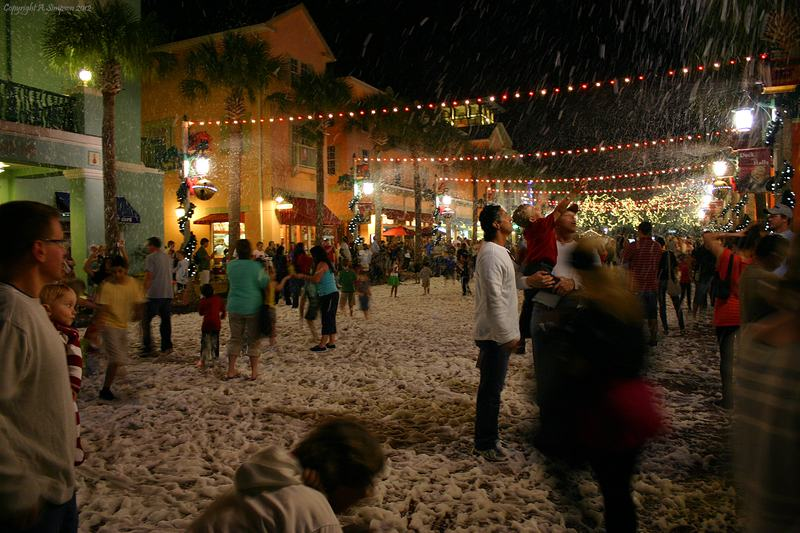 To celebrate the winter holidays, downtown Celebration is covered in 'snoap'  mdash; a soapy snow substitute that falls from the streetlamps