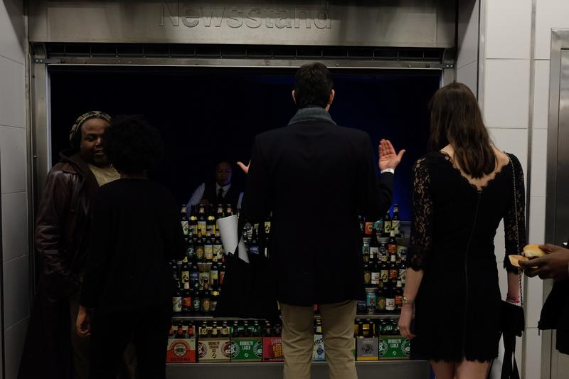 A newsstand was converted into a bar for the New Year's Eve party at the 72nd street station to celebrate the completion of three new stops on 2nd Ave.