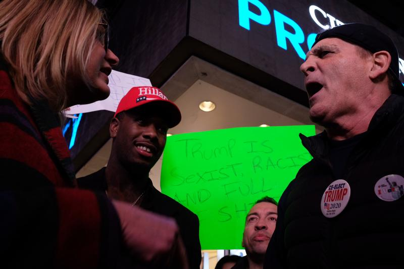 Trump and Clinton supporters clash in Times Square on election night.