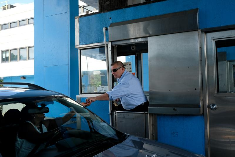 Toll booth cashier Henry Gregorio has worked in a toll booth since 1980. He knows his days are numbered, but he also loves the job.