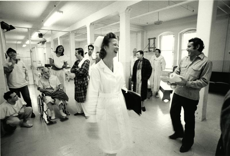 Louise Fletcher on the set of One Flew Over the Cuckoo's Nest with the cast and director Milos Forman (at right).