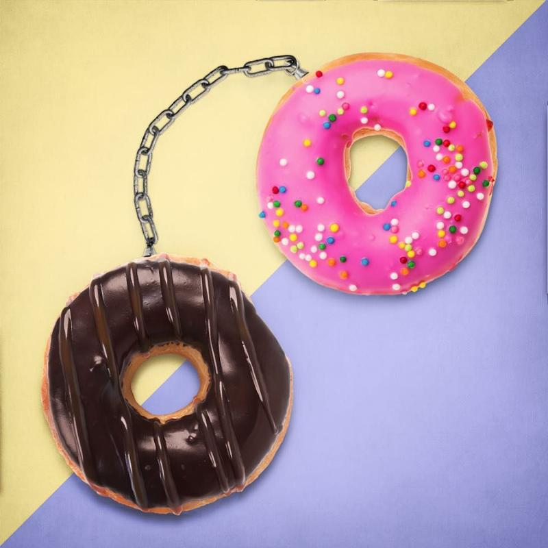 Doughnuts make handcuffs in this pop art mash up by Paul Fuentes