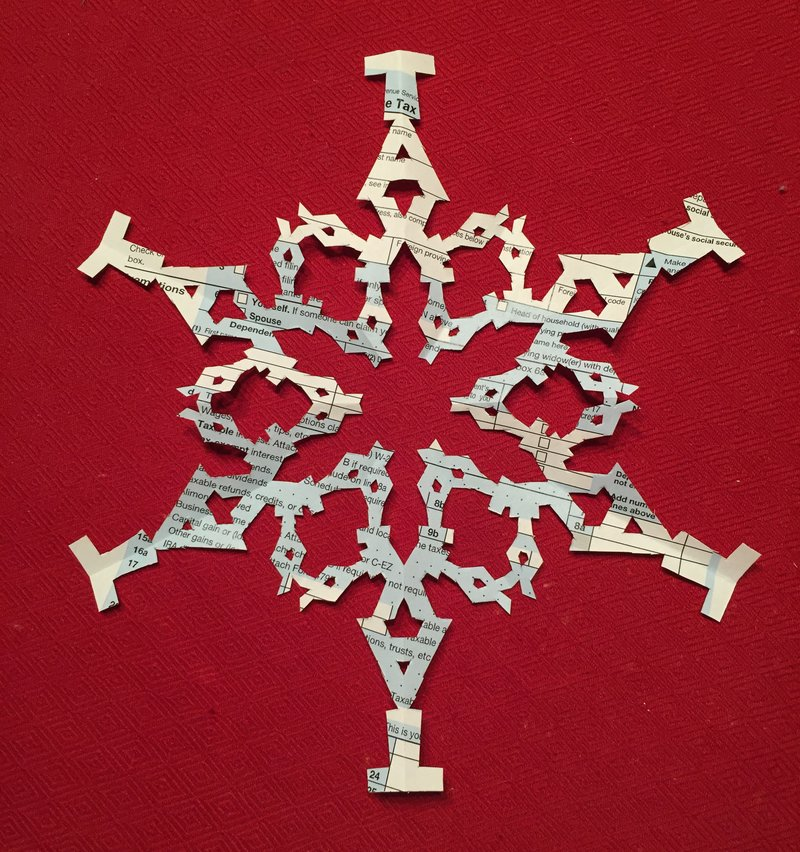 Les Barker made this incredible paper snowflake out of the tax form
