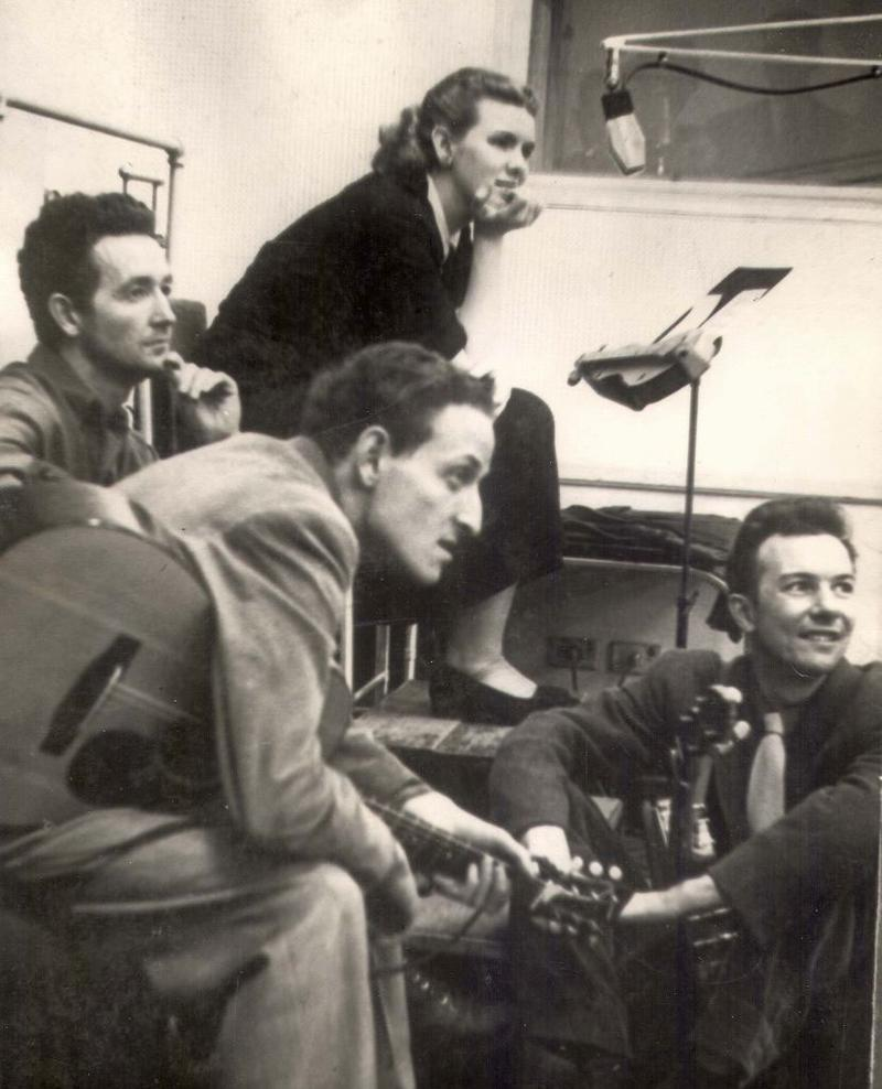 Jean Ritchie in the WNYC studios with Woody Guthrie, Peter Seeger, and Fred Hellerman. circa 1950