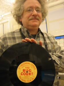 wnyc archivist andy lanset holding an artifact from the 1950 census