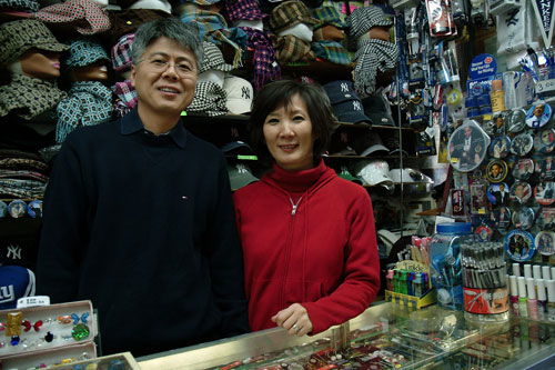 Mike and Helen Hong, run a Yankee Stadium souvenir store on 161st two blocks from Yankee Stadium