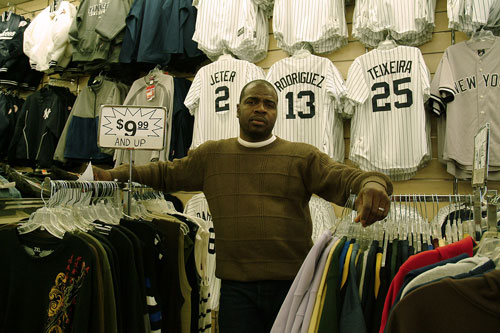 Abdule Traore, manager of Jeans Plus clothing and souvenir store