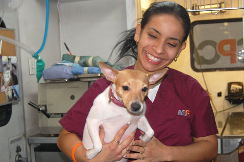 Natalia, an ASPCA vet technician, says she loves working with the mobile clinic. Her dog is a rescue, of course!