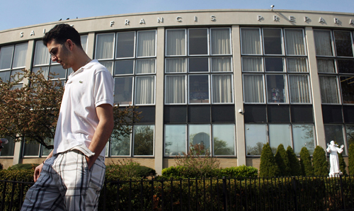 Student George Koutsothanasis stands in front of Saint Francis Preparatory School where he is a senior on April 27, 2009 in New York City. Saint Francis will be closed Monday and Tuesday.