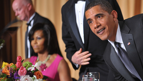 President Barack Obama and First Lady Michelle Obama take their seats for the White House Correspondents' Association annual dinner on May 9, 2009 at the Washington Hilton hotel in Washington.  (MANDEL NGAN/AFP/Getty Images)
