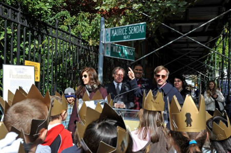 "Director Spike Jonze and actress Catherine Keener at the intersection of Greenwich Avenue and Christopher Street temporarily renamed ""Maurice Sendak Way"" and ""Wild Things Way."" (photo by Julienne Schaer / Courtesty of NYC & Company)"