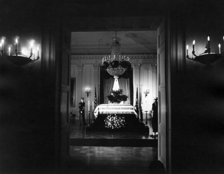 The body of President John. F. Kennedy lies in repose in the East Room of the White House. (Abbie Rowe, National Park Service)
