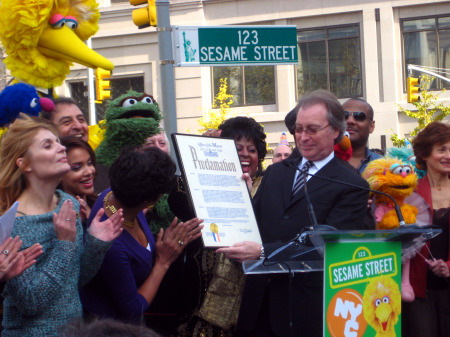 "NYC & Company CEO George Fertitta hands over a proclamation on behalf of Mayor Bloomberg, declaring Tuesday ""Sesame Street Day"" to show creator Joan Ganz Cooney. (Gayathri Vaidyanathan)"