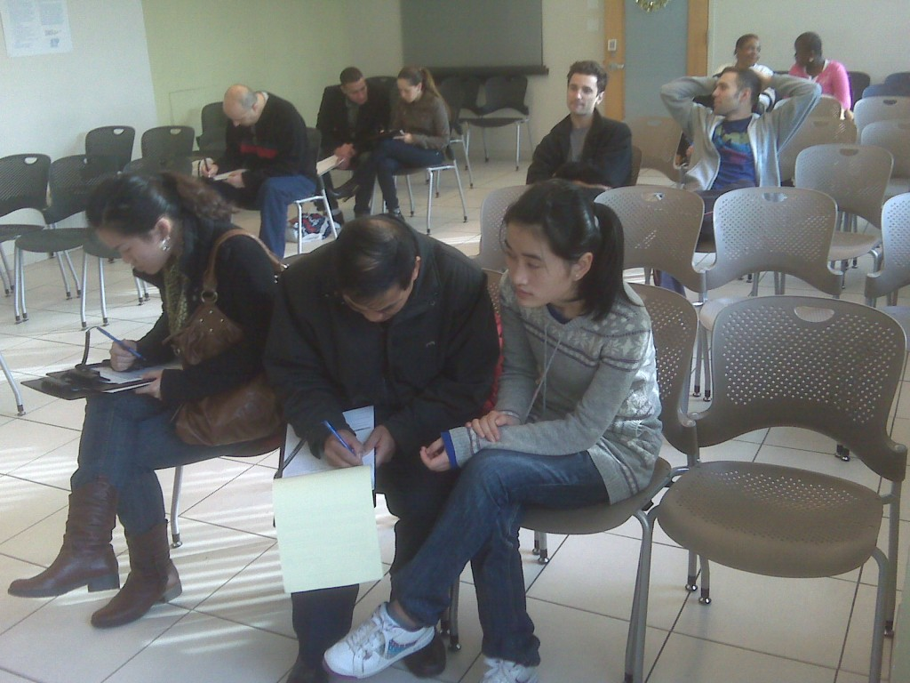 Brooklyn residents fill out paperwork and get ready for their H1N1 flu vaccines, at a health deparment clinic.