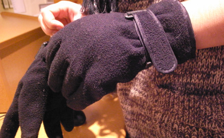 "WNYC Newsroom intern Marine Olivesi sporting a ""new"" pair of gloves. (Photo by Stephen Nessen)"