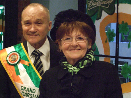 New York City Police Commissioner Ray Kelly posing with a parade marcher. (Photo by Brigid Bergin)