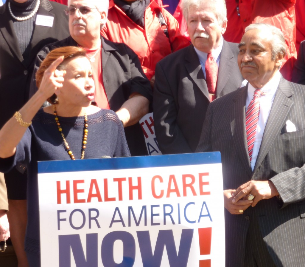 Representatives Nydia Velasquez and Charles Rangel praise activists, and activists praise them, during a celebration of health-care reform passage. (Photo by Fred Mogul)