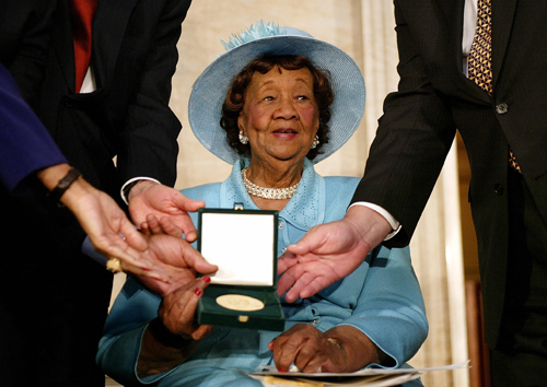 Dr. Dorothy Height is presented with the Congressional Gold Medal during a ceremony in the Rotunda at the Capitol 24 March, 2004. (Photo by Stephen Jaffe/AFP/Getty Images)